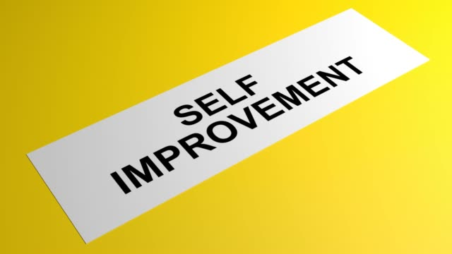 self improvement writing on a rolling yellow paper - self improvement stock videos & royalty-free footage