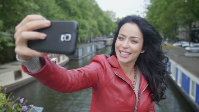 self portrait in amsterdam - one mid adult woman only stock videos & royalty-free footage
