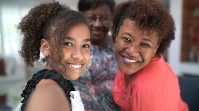 self portrait of a three generation women's family - afro stock videos & royalty-free footage