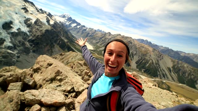 self portrait of cheering hiker on mountain top, celebrating - tourism stock videos & royalty-free footage