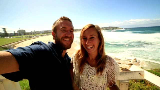 Self portrait of young couple at bondi beach, Australia