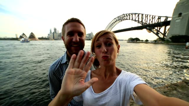 self portrait of young couple with sydney skyline - sydney australia stock videos and b-roll footage