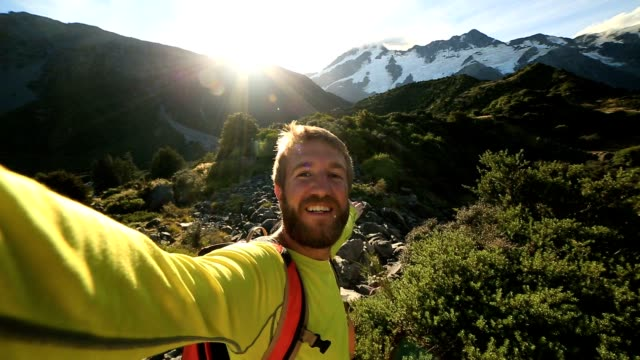 self portrait of young man hiking in new zealand - new zealand stock videos & royalty-free footage