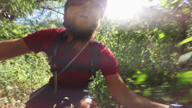 self portrait with action cam: riding a mountainbike bicycle - andare in mountain bike video stock e b–roll