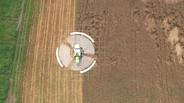 self-driving harvesters ride on wheat field and harvest - smart stock videos & royalty-free footage