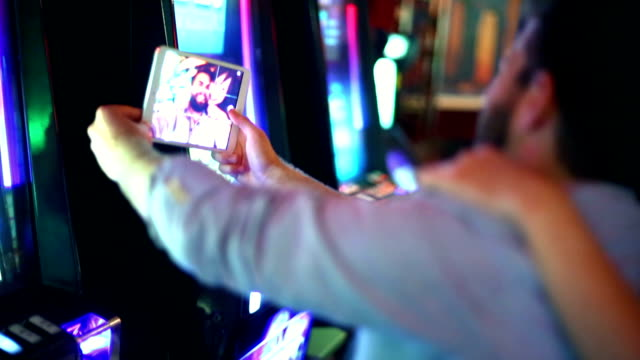 selfie addicts. - casino stock videos & royalty-free footage