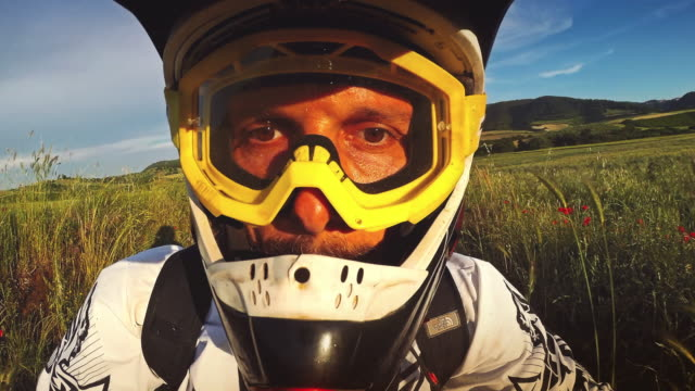 selfie arm motocross enduro bike outdoor - motocross video stock e b–roll