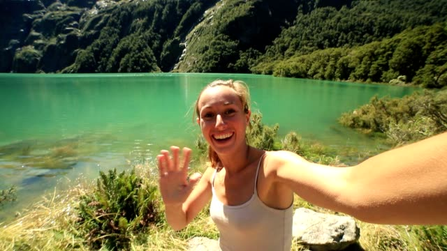 Selfie by mountain lake in New Zealand