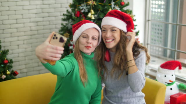 selfie christmas eve event - 25 29 years stock videos & royalty-free footage