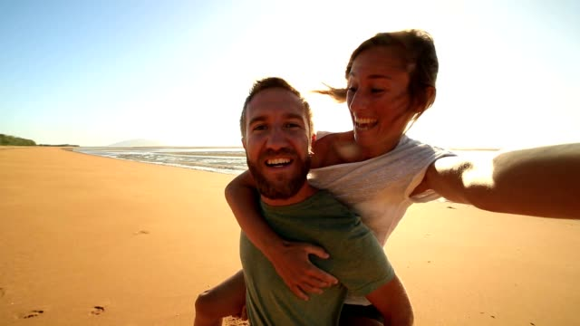selfie : couple capturing fun moments on the beach - vacations stock videos & royalty-free footage