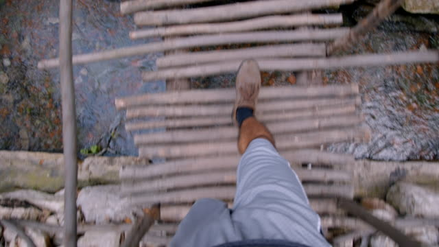 selfie - feet walking across wooden bridge - olympos, turkey - turchia video stock e b–roll