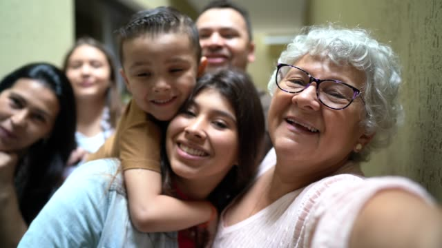 selfie of a big family reunited at home - grandparent stock videos & royalty-free footage
