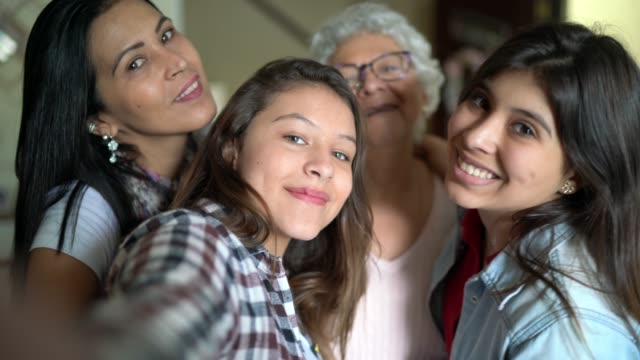 selfie of a three generation women's family at home - reunion social gathering stock videos & royalty-free footage