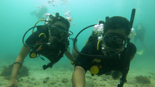 selfie of couple of scuba openwater diver training skill and dive to explore coral reef - aqualung diving equipment stock videos & royalty-free footage