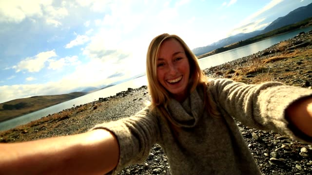 selfie of girl by the lake - hand on heart stock videos & royalty-free footage