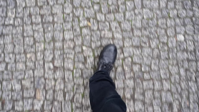 selfie of person walking down a cobblestone street on a rainy day. berlin, germany. - low section stock videos & royalty-free footage