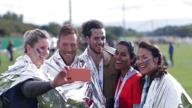 selfie of the winners - medallist stock videos & royalty-free footage