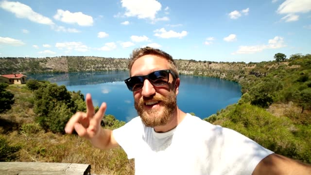 selfie portrait at blue lake, south australia - real people stock videos & royalty-free footage