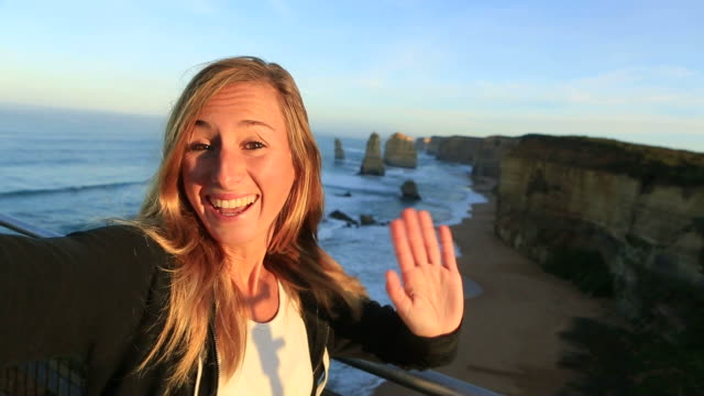 selfie portrait at sunrise of woman at the twelve apostles - youth culture stock videos & royalty-free footage