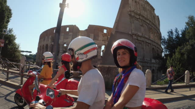 pov selfie scooter riding: friends on the motorbikes in the center of rome - scooter stock videos & royalty-free footage