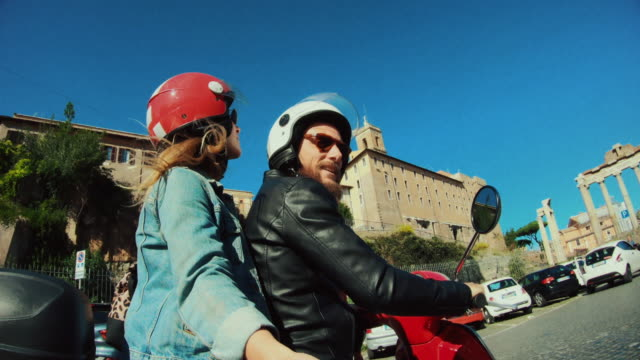 selfie scooter riding: on the motorbike in the center of rome - motorino video stock e b–roll