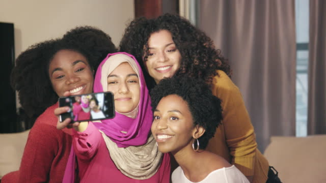 selfie shot of happy group of ethnically diverse friends - religioni e filosofie video stock e b–roll
