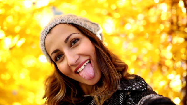 selfie video of a girl fooling around - woolly hat stock videos & royalty-free footage