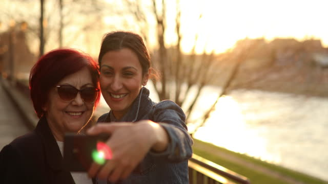 selfie with grandma - back lit woman stock videos & royalty-free footage
