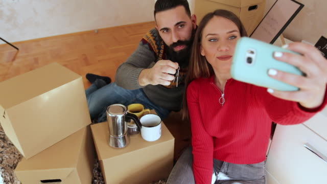 selfie with keys of the new home - young couple stock videos & royalty-free footage
