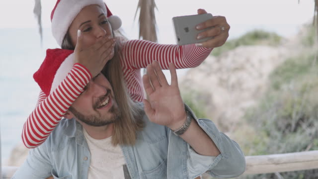selfie with santa claus caps - santa hat stock videos and b-roll footage