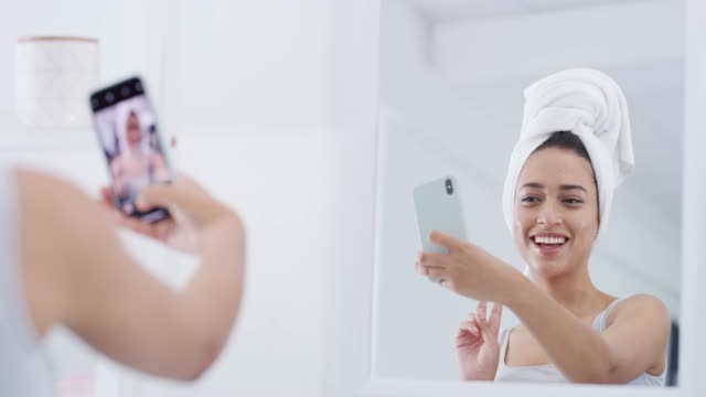 selfies are a must when you're looking this good - skin care stock videos & royalty-free footage