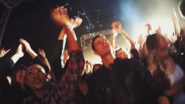selfiestick in concert crowd - rocking stock videos & royalty-free footage