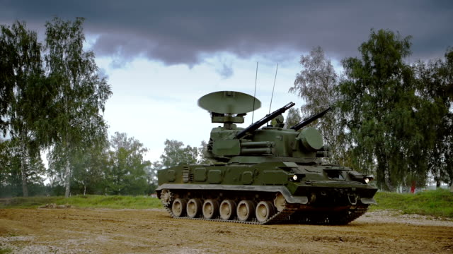 self-propelled anti-aircraft vehicle on dirt road - anti aircraft stock videos & royalty-free footage