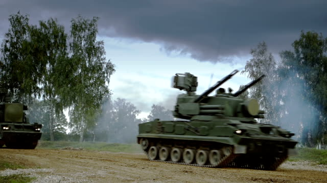 self-propelled anti-aircraft vehicles on dirt road - armoured vehicle stock videos and b-roll footage