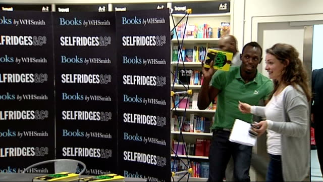 selfridges in row over dining edl leader / usain bolt book signing; england: london: selfridges: int various shots of usain bolt dodging backwards... - biographie stock-videos und b-roll-filmmaterial
