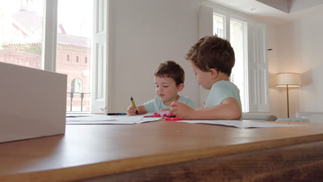self-study activities. little boys doing homework. coronavirus epidemic quarantine - quaderno video stock e b–roll