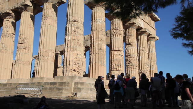 selinunte, tourists standing in front of temple e, from the 5th century b.c. - circa 5th century stock videos & royalty-free footage