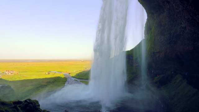 seljalandfoss waterfall in iceland, slow motion - seljalandsfoss waterfall stock videos and b-roll footage