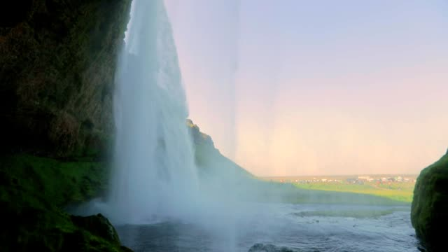 seljalandsfoss waterfall in iceland, slow motion - seljalandsfoss waterfall stock videos and b-roll footage