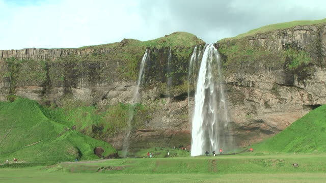 seljalandsfoss waterfall in south iceland - seljalandsfoss waterfall stock videos and b-roll footage