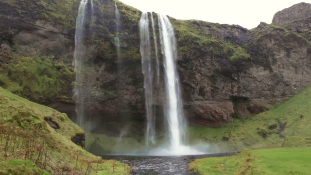 seljalandsfoss waterfall southern iceland raining seljalands river cliffs - seljalandsfoss waterfall stock videos and b-roll footage