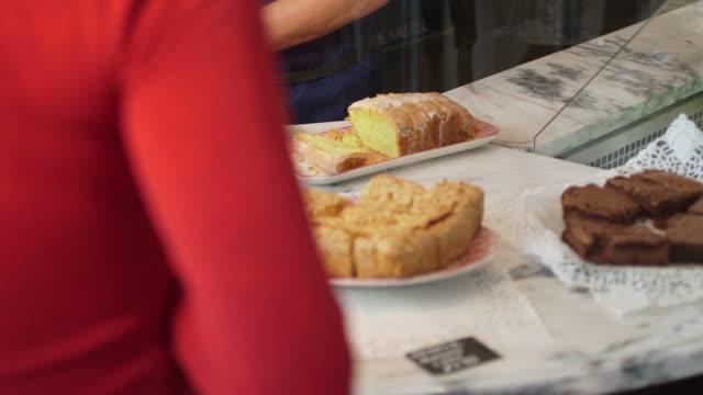 Seller giving cake to customer