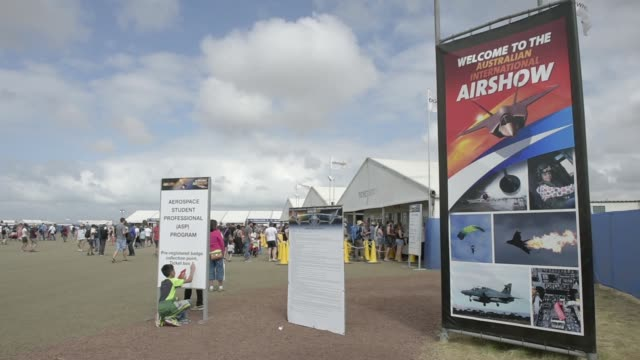 Sellers of souvenir guides stand at the entrance to the Australian International Airshow held at Avalon Airport in Geelong Australia on Friday March...