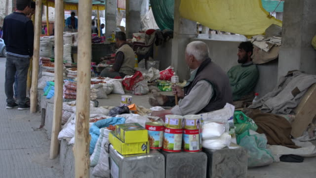 sellers selling stuff on the main bazaar (market) in leh, ladakh - retail occupation stock videos and b-roll footage