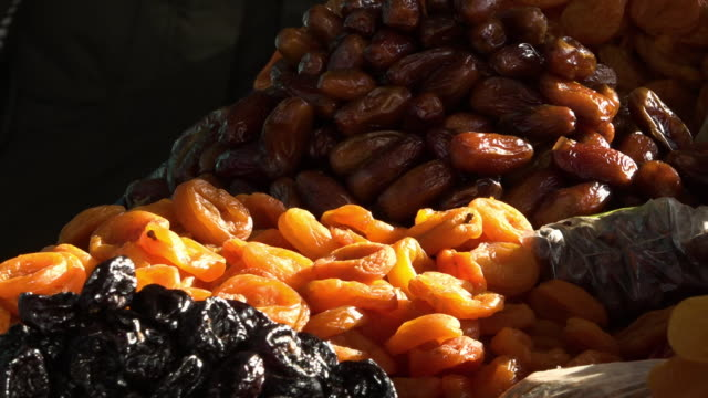 selling dried fruits and nuts on a market - dessert stock videos & royalty-free footage