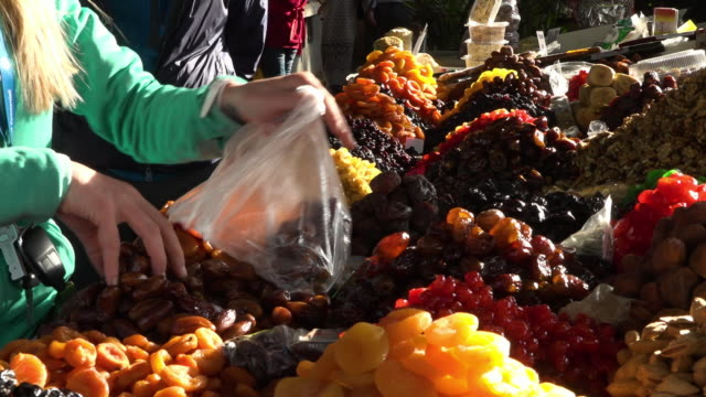 selling dried fruits and nuts on a market - pistachio nut stock videos & royalty-free footage