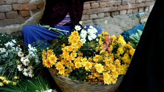 selling flowers on a market in Bagan, Myanmar