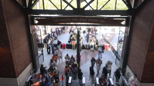 A sell-out crowd for the San Francisco Giants day game go through turnstiles at the main entrance to the AT and T Park in San Fransisco, California.