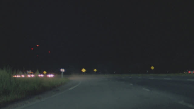 vidéos et rushes de semi on freeway straight to camera, stops full frame on grill - night - plein cadre