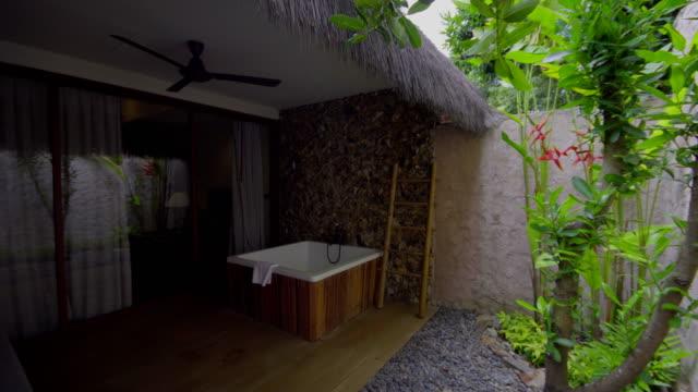 semi outdoor bathtub in the garden - villa stock videos & royalty-free footage